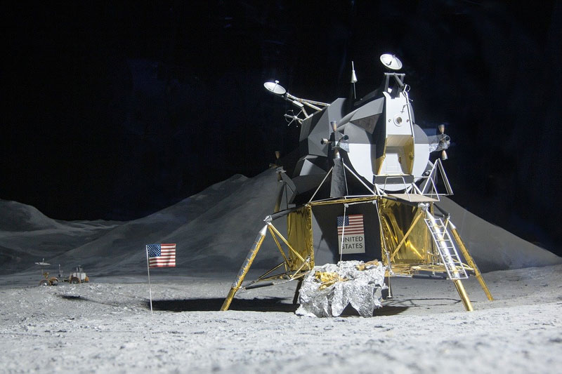 Lunar lander controlled by joystick with rocker switch